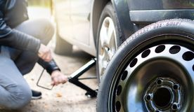 Free Driver Changing Spare Tyre After Accident. Stock Photo - 103769910