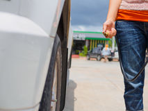 Driver checking air pressure. And filling air in the tires close up Stock Photo