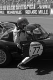 Driver climbs his car at Le Mans Royalty Free Stock Images