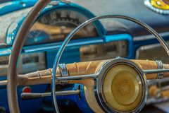 Driver cockpit and the steering wheel of a vintage car. Driver`s cockpit and the steering wheel of a vintage classic car Royalty Free Stock Photography
