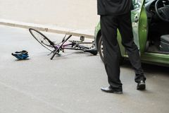 Driver after collision with bicycle. Close-up Of Male Driver After Collision With Bicycle On Road stock image