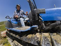 Driver on crawler tractor viewed from below Stock Photography