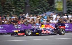 Driver Daniel Ricciardo of Red Bull Racing Team. KYIV, UKRAINE - MAY 19, 2012: Daniel Ricciardo of Red Bull Racing Team drives RB7 racing car during Red Bull Royalty Free Stock Photos