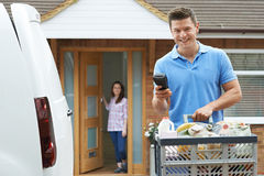 Driver Delivering Online Grocery Order. Portrait Of Driver Delivering Online Grocery Order stock images