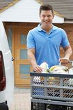 Driver Delivering Online Grocery Order To House. Portrait Of Driver Delivering Online Grocery Order To House stock photography