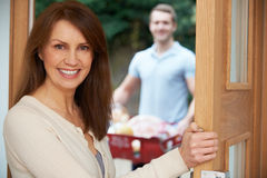 Driver Delivering Online Grocery Shopping Order. Driver Delivers Online Grocery Shopping Order Stock Photography