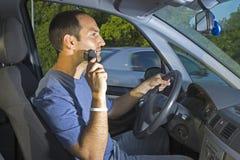 Driver distratto Immagine Stock