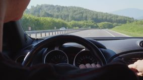 The driver is driving in the car from the inside.  stock footage