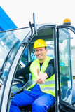 Driver driving  construction excavator Stock Images