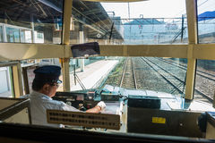 Driver driving the express train Yufuin no Mori Stock Photos