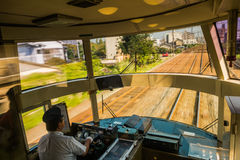 Driver driving the express train Yufuin no Mori Stock Photography