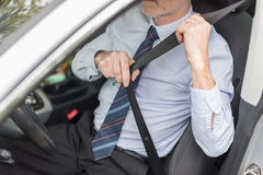 Driver fastening his seat belt. Before starting car Stock Photo