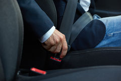 Driver fastens his seat belt Stock Photography