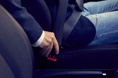 Driver fastens his seat belt, toned Stock Photo