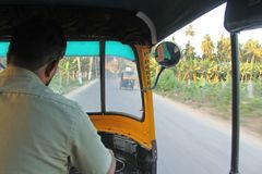The driver is a fat tuk in Hampi. A look from the passenger side stock images