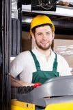 Driver felice del carrello elevatore immagini stock libere da diritti