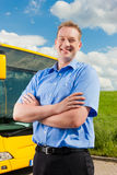 Driver in front of his bus Royalty Free Stock Photos
