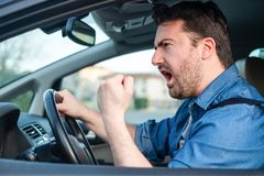 Angry and rude man driving road rage stock photography