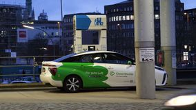 Driver fueling a hydrogen-powered car Toyota Mirai. HAMBURG, GERMANY - MAR 21, 2018: Ecologic Clever Shuttle car sharing with male driver fueling at station a stock video footage