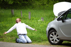 Driver furious a broken car. By the road Stock Photography