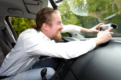 Driver furious on GPS navigation Stock Photo