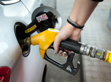 Driver at gas station. Driver pumping gasoline at the gas station Royalty Free Stock Photo