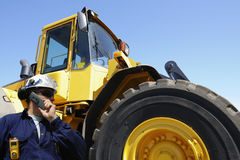 Driver and giant forklift Royalty Free Stock Images