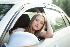 Driver the girl got stuck in traffic Royalty Free Stock Photo