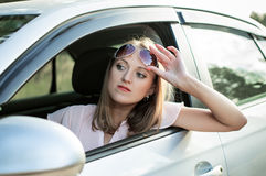 Driver girl looks way Royalty Free Stock Photos