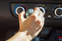 Driver hand shifting gear shift knob manually, selective focus.  royalty free stock photography