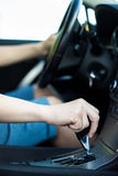 Driver hand shifting the gear stick. Close up of driver hand shifting the gear stick Stock Image