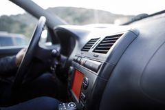 Driver hand on the steering wheel stock image
