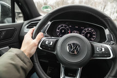Driver hand on a steering wheel Stock Images