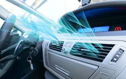 Driver hand tuning air ventilation grille. Fresh air is coming out Stock Image