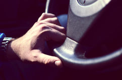 Driver hands holding steering wheel Royalty Free Stock Image