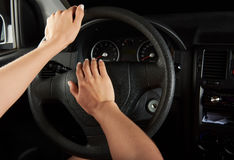 Driver hands using horn Royalty Free Stock Images