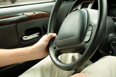 Driver holding steering wheel. Man driving a car, holding steering wheel Stock Image