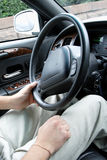 Driver holding steering wheel Stock Photo