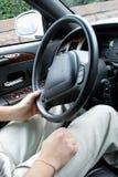 Driver holding steering wheel. Luxury car Stock Photo