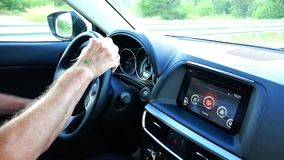 The driver holds the steering wheel firmly and drives the vehicle.  stock video