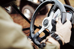 Driver holds the steering wheel with gloves Stock Image