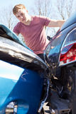 Driver Inspecting Damage After Traffic Accident Royalty Free Stock Photo