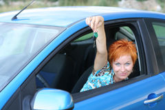 Driver with key from new car Stock Photo
