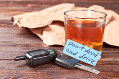 Driver keys, glass of alcohol, message. royalty free stock photos