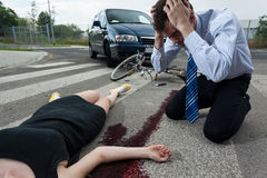 Driver killed female cyclist. Horizontal view of a driver killed young female cyclist stock photos