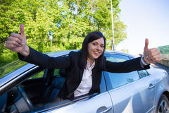Driver license concept - happy woman with car. Driver license concept - happy woman with her car Stock Images