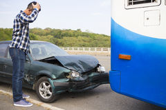 Driver looking at car After Traffic Accident on the roa Royalty Free Stock Photos