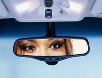 Driver looks to rear view mirror Royalty Free Stock Photography