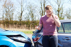 Driver Making Phone Call After Traffic Accident Royalty Free Stock Photo