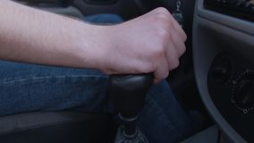 Change gear in car. Driver man controls auto and switch gears. Close up of gear shift in car. Gearbox auto of manual transmission stock footage